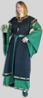 Pictured: Black sleveless overtunic with trim over Anglo Norman Dress,green ring belt and viking cup